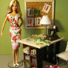 Barbie in her sewing room. Patterns on the bulletin board are miniatures made from photos of actual vintage sewing patterns.