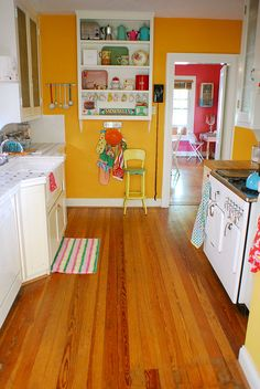 Yellow Kitchen... that shelf looks a little high for my vertical challenges, BUT, the look of this is beautiful!