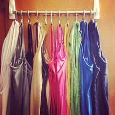 Command hooks, rod and shower curtain hooks to hang tank tops!