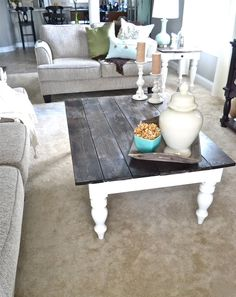 I want to redo the coffee table in my scrap pile just like this...white distressed legs, dark stained top