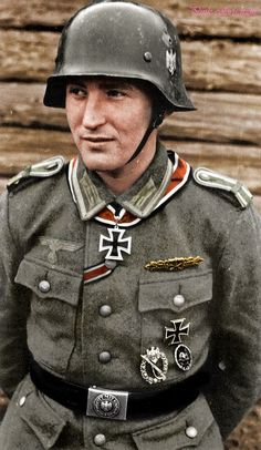 Lieutenant Karl Radermacher, a Wehrmacht war hero poses for a photograph at the Front. Radermacher was a recipient of the highly coveted Knights Cross of the Iron Cross for his selfless bravery in battle.