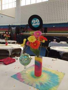 Full table centerpieces - disco balls made by Carol tie-dye center cloth made by Molly. An electric candle inside made the centerpiece glow in the dark room