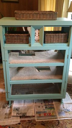 DIY 3 story bunny hutch with shelf for storage. Made from an old dresser.