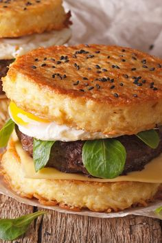 "Burger with Fried Egg and Ramon ""Bun"" Recipe - with Ground Beef, Soy Sauce, Sesame Oil, Vegetable Oil, American Cheese, Ketchup, Sriracha, and Arugula"