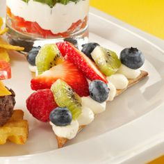 Mixed Berry Pizza Recipe -The fresh fruit shines through in this colorful dessert pizza. It's also a tempting appetizer at parties because it's a sweet change of pace from the usual savory dips. —Gretchen Widner, Sun City West, Arizona