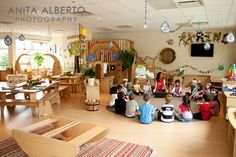 I love this classroom environment. The tables allow for collaboration with other student. The bridge in the room promotes exploration and imagination. The bridge can be used for many things. They can build a fort or pretend its a castle. And the overall environment of the classroom is very calming. And the giant windows allow for natural light in the classroom.