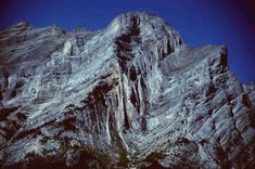 Anticlines and synclines commonly found next to each other. This mountain side in the Canadian Rockies exposes a good example of an anticline-syncline pair.