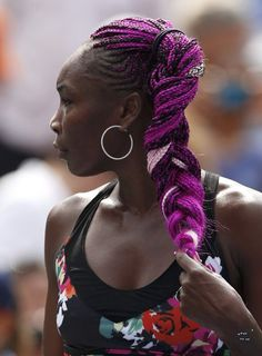 Venus Williams fixes her hair after her victory over Kirsten Flipkens of Belgium at the U.S. Open tennis chammpionships in New York, August 26, 2013.