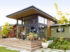 Relatively flat middle roof. Hardie cement panels, wood siding, standing seam metal side roof. Notice wrap around steps for deck.  Knowles Residence Bainbridge Island, WA by Coates Design Architects. Hozz. http://www.houzz.com/photos/118670/Knowles-Residence---Exterior-modern-exterior-seattle#