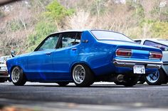 Datsun B210 -  This is sort of like the one I had.  Mine was 2dr coupe and gun metal gray with a spoiler on the trunk... Man, I miss that car.