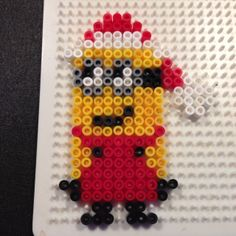 Christmas Minion hama perler beads by elberg5 - Pattern: http://www.pinterest.com/pin/374291419004981729/