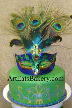 Mardi Gras custom green, gold and purple fondant birthday cake with peacock feather mask topper