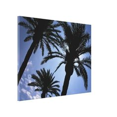 Beach art on canvas with three tropical palm trees in silhouette with the sunshine and beautiful blue sky. Instantly give your walls a tropical decor with this unique perspective.