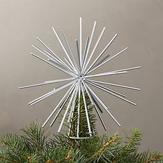 On sale. Iron wire star tops the tree with a burst of energy and beauty. Graphic and modern, shiny silver tree topper is a perfect finishing touch for any Christmas tree. Looks stunning from every angle. Star Tree Topper, Silver Tree Topper, Diy Tree Topper, Unique Tree Toppers, Modern Holiday Decor, Unique Christmas Decorations, Christmas Tree Toppers, Christmas Ornaments, Xmas