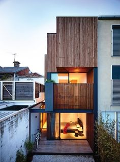 Wellard Architects. The rear facade is largely solid or screened in response to privacy issues, but also gives a strong sense of clarity to the form of the building.