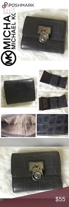 """Michael Kors Signature Trifold Wallet Michael Kors Signature Trifold Wallet, Gator Embossed Grey Leather with Silver Hardware, 8 Total Card Slots, 1 ID Clear Slot, 1 Zip Coin Compartment, 1 Long Compartment for Bills, Approx. Size is 4 1/2""""x 3 3/4"""" when Closed and 10"""" Long when Open, Used in Good Condition! Michael Kors Bags Wallets"""