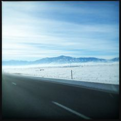 PROJECT 365: Day 53 - Jan. 9, 2013    Somewhere in Utah.    We drove towards the sun all morning. The strange haze that settled over the landscape often made the mountains look like a mirage.