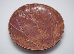Serving platter with leaf impression design in plum colors