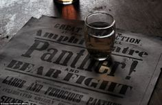 Dust gathers on an old poster advertising a 'Panther and Bear Fight' at the Wild West them...