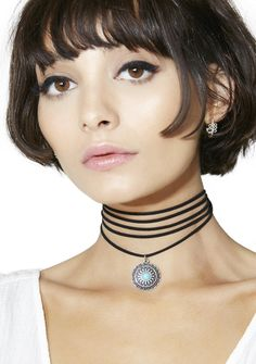 Atlantis Pendant Choker fer when yer goin' on a journey, babe. This necklace features a black wrap around cord band so yew can customize yer look and a silver circle engraved pendant with a turquoise colored stone in the center.