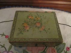 Antique Brook's sewing thread box green with pink roses.