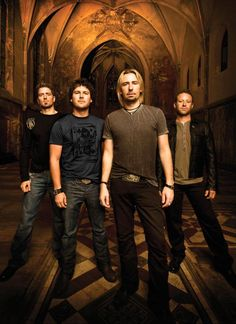 30 Day Band Challenge, Day 2:  A picture of your least favorite band.    Answer:  Nickelback.  These guys have been so over-popularized and waaay over-rated.  I'm sick of it, and the lead singer sounds like Cher.  Tomorrow, Day 3:  A good-looking band (i.e. - Queen Caveat)