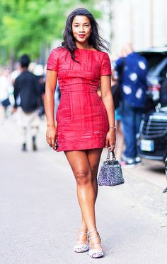 Hannah Bronfman wearing a red cocktail dress looks polished in with a structured bag and lace-up heels.