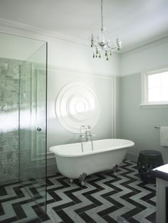 Love how the designer thought to continue the chevron into the shower.  Seamless!