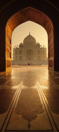 Taj Mahal, India. It has an ugly side too... All the artisans hands were cut off on completion, so they couldn't create anything of equal beauty. :(