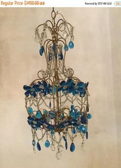 Beautiful Vintage Crystal Chandelier! Loving the blue! A personal favourite from our Etsy shop https://www.etsy.com/listing/546792760/sale-chandelier-lighting-crystal