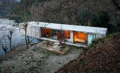 Concrete House Overlooking River Views by Correia/Ragazzi Aquitectos