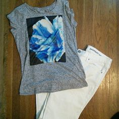 EXPRESS T-shirt Floral image is a silky applique, not screen printed to shirt for an extra special look. 85% polyester, 15% linen. Express Tops Tees - Short Sleeve