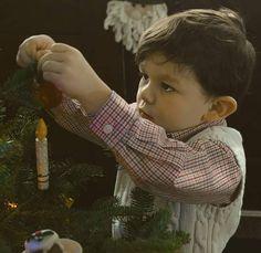 Concentration on decorating the tree #oliverthekid #Oliver #christmastree #christmaspictures #toddler #festive #decoration
