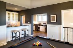 This dream game room includes its own gorgeous bar area. Highland Homes | Rough Hollow | Game Room | Lakeway, TX | Plan 617
