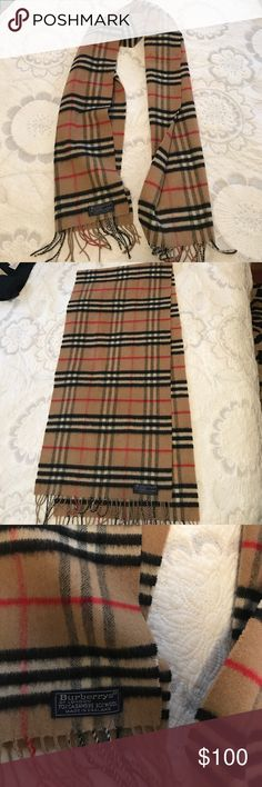 "Burberry Scarf Authentic Vintage Burberry Scarf. Worn but still great condition, minus the few small marks shown that can definitely be removed with dry cleaning. The length is 52"" x 12"" Burberry Accessories Scarves & Wraps"
