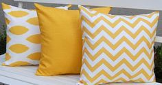 Yellow pillows- to go on a neutral couch with a grey and white chevron rug underneath- in our future living room :)