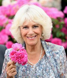 Camilla Parker Bowles Photos - Camilla, Duchess of Cornwall smells a flower as she visits Sandringham Flower Show on July 2016 in Sandringham, England. - The Prince of Wales & Duchess of Cornwall Visit the Sandringham Flower Show 2016 Royal Prince, Prince Of Wales, Royal Marriage, Camilla Duchess Of Cornwall, Camilla Parker Bowles, Lady In Waiting, Devon And Cornwall, English Royalty, Herzog