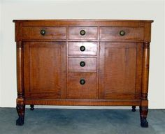 Empire tiger maple and cherry sideboard. Ca 1840.