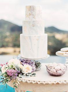 Watercolors and gold leaf wedding cake:http://www.stylemepretty.com/2015/09/01/elegant-malibu-rocky-oaks-estate-shoot/ | Photography: Sally Pinera - http://sallypinera.com/