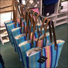 Ocean-like colors reach out for attention from this Martha Stewart Beach Tote T-Stand. Cute and casual they are perfect for the Beach, just as intended. Retail Fixtures, Store Fixtures, Visual Merchandising, Martha Stewart, Hooks, Shape, Tote Bag, Beach, Fit