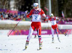 Marit Bjoergen of Norway wins the Women's 30 km Mass Start Free
