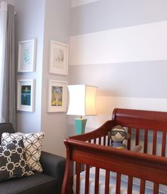The subtle striped wall is perfect for a nursery
