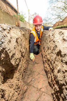 Archaeologists have found the location of one of the the lost Tiltyard Towers at Hampton Court Palace. Here they show an uncovered green tiled floor.