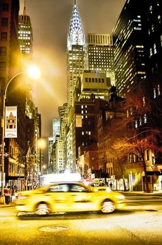 Those yellow taxis cabs and the Chrysler Building in the background ... I love New York!