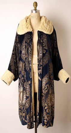 Gold stenciled midnight blue silk velvet evening coat with ivory fur cuffs and collar, by Maria Gallenga, Italian, 1925-26.