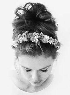 Holland Roden messy bun with a flower headband