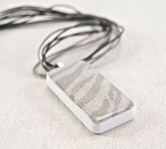 Silver Shimmer Zebra Print Domino Pendant with Gray Corded Necklace