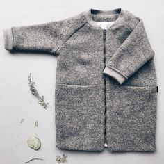 So it's Friday already and looking out the window it's not so cosy! These coats will keep your little one warm they are online and already going fast Thank you so much! On the product pages we've included a sizing table to help you pick the right size! #monkind #woolcoat #taigacollection #aw16 #greymelange #kidswear