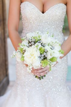 sparkly allure bridals gown with a winter bouquet