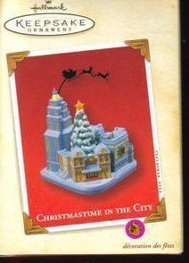 Hallmark Keepsake Ornament-Christmastime In The City  This 2003 Hallmark Keepsake Christmas ornament features a silhouette of Santa Claus flying over the city. When the city sleeps on Christmas Eve, when all the bustle stops, a jolly sillhoutte appears among the building tops. Designed by Artist John Collin Francis.